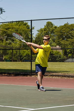 Young tennis player practicing backhand shot. Stock Photo