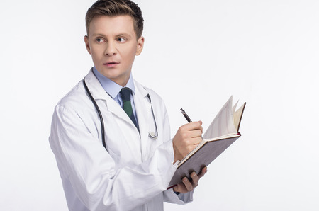 x ray equipment: Portrait of male doctor with stethoscope engaged in his work.