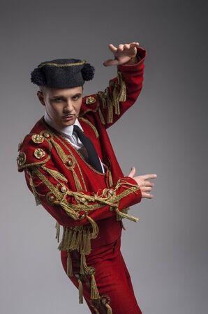 matador: Studio shot of a man dressed as Spanish torero, matador, bullfighter.