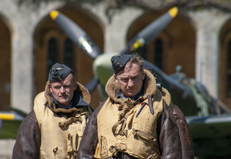 Lincoln, England - May 07, 2018: Reenactors dressed as WWII Pilots at an event celebrating 100 years of military flying