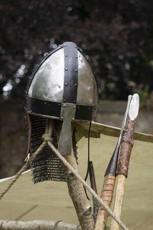 A medieval helmet and spears. Stok Fotoğraf