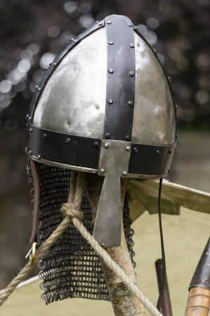 A Norman knights helmet with a nose guard and chain mail neck protection. Stok Fotoğraf