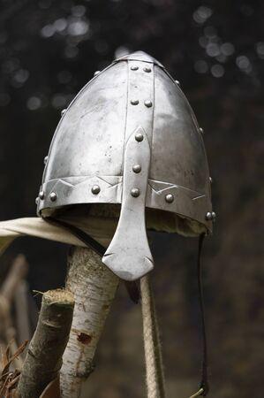 A Norman style helmet on a wooden pole. Stok Fotoğraf
