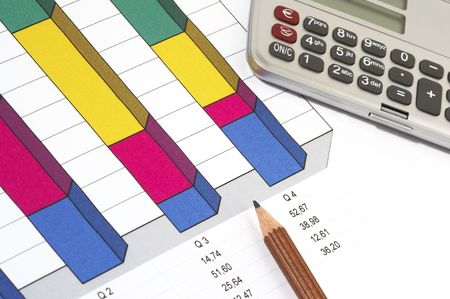 Colorful Sales Report and Chart with pen and calculator photo