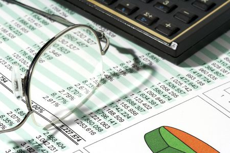 Sales Report and Chart with calculator and glasses photo