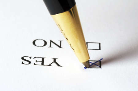 tickbox: Tickbox with a blue cross on YES an a golden ballpointer