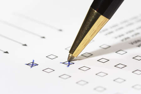 different columns with checkboxes, voting with ball pen by tick photo