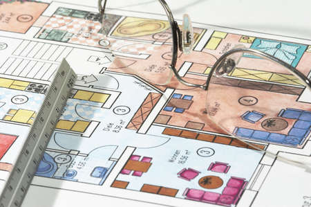 Colored plans of apartment, ruler and glasses photo