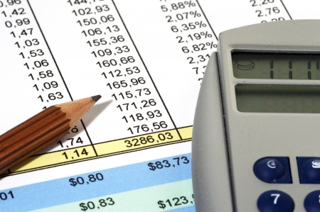 Colorful Sales Report with pen and calculator Stock Photo