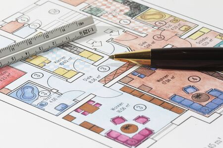 revise: Colored plans of apartment, ruler and ball pen