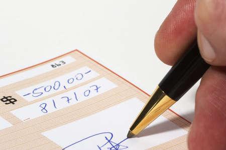 Writing a bank check photo