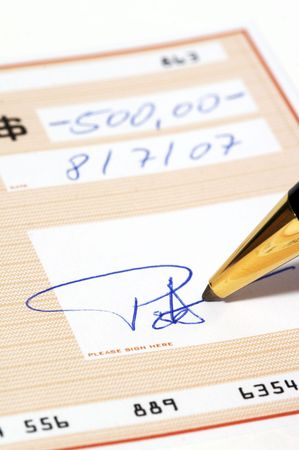 Writing a bank check Stock Photo - 724454