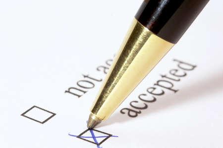 tickbox: Tickbox with a blue cross on ACCEPTED an a golden ballpointer Stock Photo