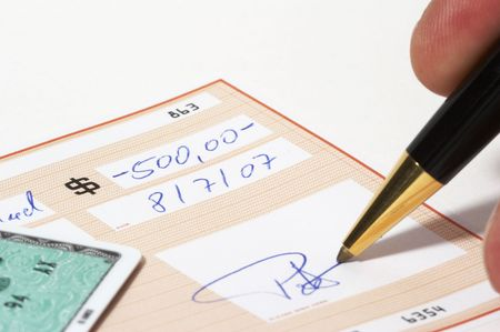 Writing a bank check - note: check, numbers and signature are fictitious! photo