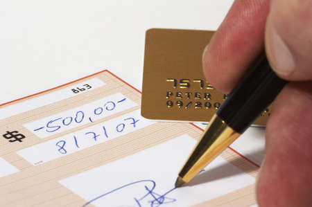 Writing a bank check - note: check, numbers and signature are fictitious! Stock Photo - 723774