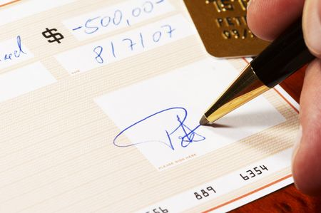 Writing a bank check - note: check, numbers and signature are fictitious! Stock Photo - 723773