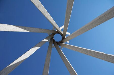 tipi: wigwam abstract made of white stone - blue cloudless sky - format portrait