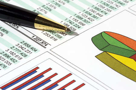 cash flow statement: Sales Report and Chart with pen Stock Photo
