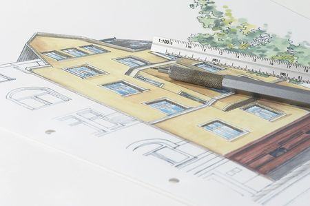 Colored plan of residential building, pencil, ruler