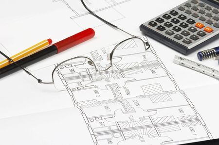cad blueprint with glassesm penclis, ruler and calculator photo