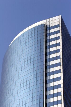 reflectivity: modern skyscraper and blue sky