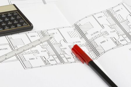 cad blueprint with calculator, pencil and ruler photo