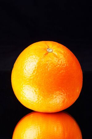 ingest: colorful orange on a mirror - black background - protrait format