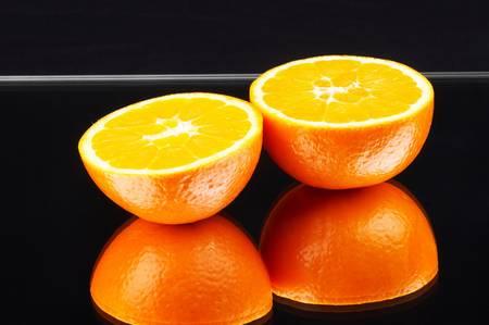 colorful orange on a mirror - black background - landscape\ format