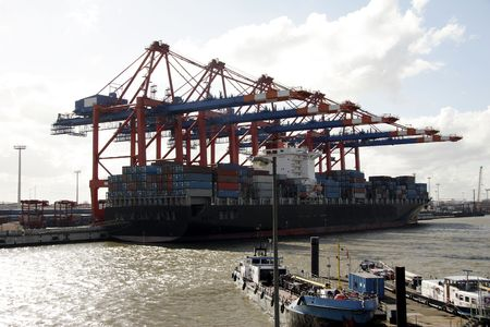 payload: The port of Hamburg is the central hub for trade with Eastern and Northern Europe. As a container port, Hamburg takes second place in Europe and seventh place in the world. It is 120 km from the sea, but can nevertheless take the largest container ships i Stock Photo