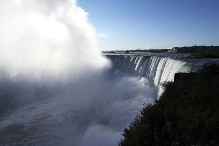 Horseshoe Falls (Canadian Falls) is part of the Niagara Falls located on the Niagara River on the border of Canada. Stock Photo