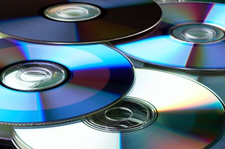 Many colorful DVD lying upon each other - landscape format Stock Photo - 802059