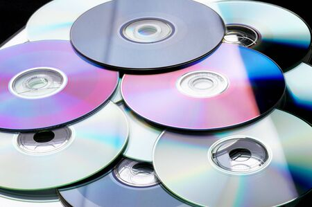 Many colorful DVD lying upon each other - landscape format Stock Photo - 802060