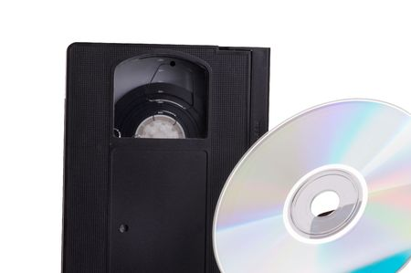 Abstract contrast of the evolution from video cassette to DVD - isolated on white background Stock Photo - 802107