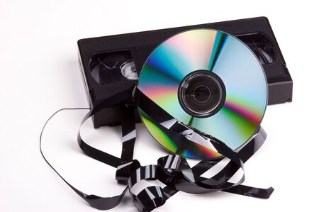 megabyte: abstract contrast between video cassette and dvd on white background Stock Photo