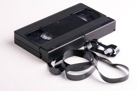 broken video cassette on white background