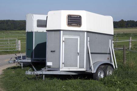 silver horse trailer on green weadow