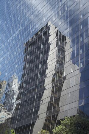 reflectivity: Reflexion of a house facade in a modern office building with light bend in the front