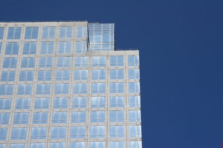 reflectivity: geometrical skyscraper rises in the cloudless sky Stock Photo