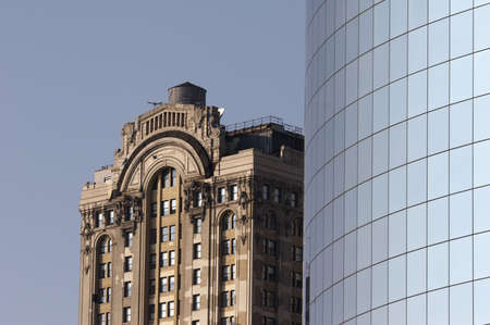 reflectivity: old and new, modern office building Stock Photo