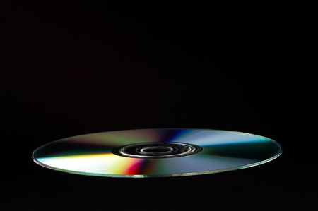 DVD Disc on black background - landscape format photo