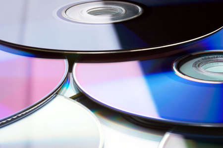 dvdr: Many colorful DVD lying upon each other - landscape format