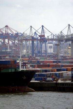 The port of Hamburg is the central hub for trade with Eastern and Northern Europe. As a container port, Hamburg takes second place in Europe and seventh place in the world. It is 120 km from the sea, but can nevertheless take the largest container ships i Stock Photo