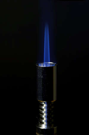 small gas burner with flame photo