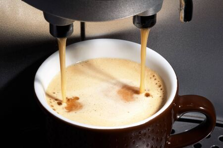 coffe dispenser with cup of coffee photo