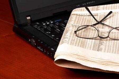 powerbook: Desk with laptop, newspaper, glasses