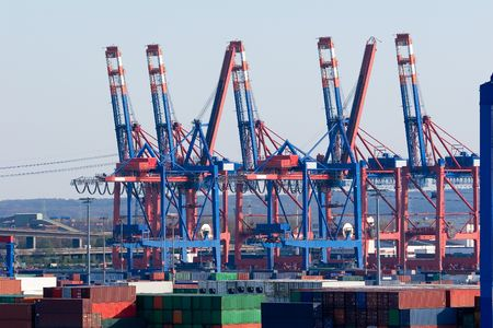famous industries: The port of Hamburg is the central hub for trade with Eastern and Northern Europe. As a container port, Hamburg takes second place in Europe and seventh place in the world. It is 120 km from the sea, but can nevertheless take the largest container ships i Stock Photo
