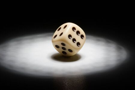 a mirage: Dice in the spotlight - black background