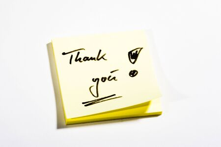 Yellow Post-It with Thank you - on white background photo