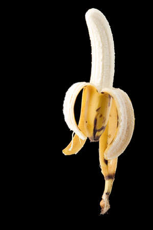Yellow banana on black background - portrait format Stock Photo