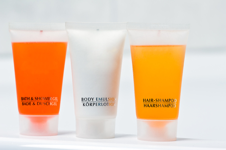 Colorful bottles of beauty products like bath- and showergel, body lotion, hair-shampoo